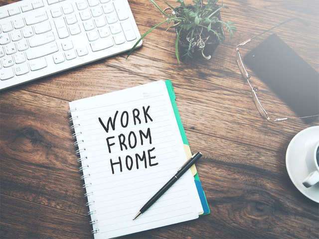 work from home written on a journal over a wooden table